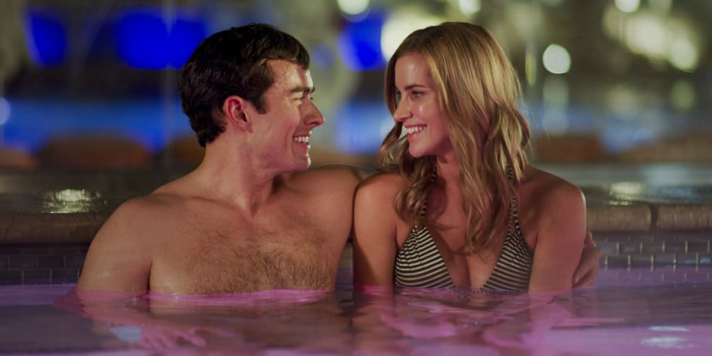 Couple enjoying hot tub at The Pool.